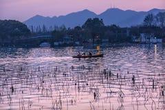Boat Pink Reflection Sunset West Lake Hangzhou Zhejiang China Royalty Free Stock Photography