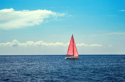 The boat with pink sail Royalty Free Stock Image