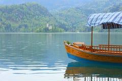 Boat pletna on lake bled Royalty Free Stock Photo
