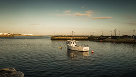 Boat in poirt during a sunset Royalty Free Stock Photo