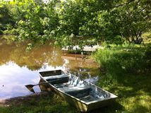 Boat in pond. Old boat around pound Stock Image