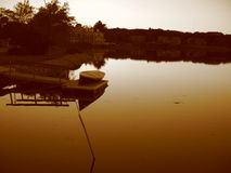 Boat and Pond at Sunset in Sepia. In Maine stock image