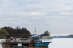 A boat and a pontoon on the river Stock Photography
