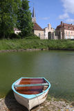 Boat in the pool and village Stock Photos