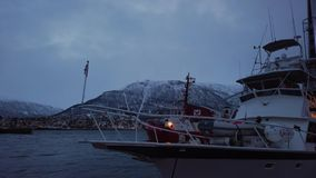 Boat moored in Tromso harbour. Boat in port and harbour in Tromsoysundet strait in Tromso, Northern Norway stock footage
