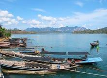 Boat at port. Many fishing boat at port, waiting for traveller to sight seeing at Ratchaprapa Dam, Khaosok National Park, Suratthani, thailand Stock Photo