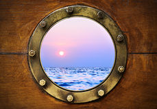 Boat porthole. With ocean view close up Royalty Free Stock Photos