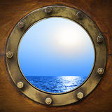 Boat porthole. With ocean view close up Stock Image