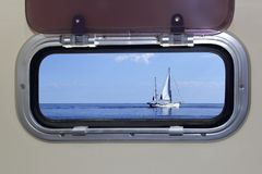 Boat porthole sailboat view blue ocean sea Royalty Free Stock Images