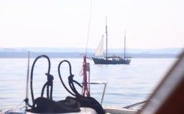 Boat porthole sailboat view blue ocean sea sky horizon. Outdoor sport Stock Photos