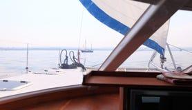 Boat porthole sailboat view blue ocean sea sky horizon. Outdoor sport Stock Photo