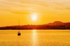 Boat at Porto Rotondo at the Mediterranean Sea. On Costa Smeralda in Sardinia in Italy at sunrise stock photography