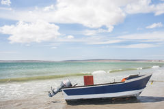 A boat with power motor out of water. Royalty Free Stock Image