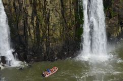 Boat practicing extreme sports, giant waterfall, beautiful landscape between rocks. Water river waterfall nature forest stream landscape tree trees green creek royalty free stock image