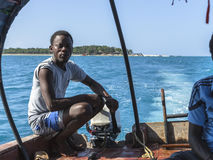 Boat from  Prison Island to Zanzibar Town. Local man taking tourists  from  the Prison Island to Zanzibar on his boat Royalty Free Stock Photo