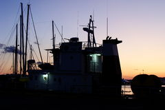 Boat profile at the sunset in the port Royalty Free Stock Photo
