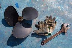 Boat propeller improvement repair tools and gloves. Boat propeller improvement tools and gloves during a repair work Royalty Free Stock Photos