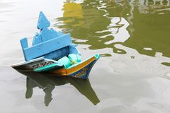 Boat prow emerges above the water Stock Photo