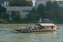 Boat pulled by a cable crossing the rhine with tourists Stock Photos