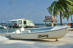 Boat pulled up on the beach stock image