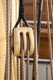 Boat pulley. Pulley for sails and ropes made from wood on an old sail boat Stock Photo
