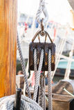 Boat pulley. Pulley for sails and ropes made from wood on an old sail boat Stock Image