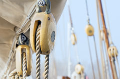 Boat pulleys. Many wooden blocks equipping an old sailboat royalty free stock photos