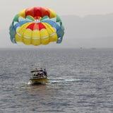 A Boat Pulls Colorful Para Sailing At The Blue Sea. Eilat 2017. Stock Image