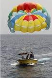A Boat Pulls Colorful Para Sailing At The Blue Sea. Eilat 2017. Stock Photos