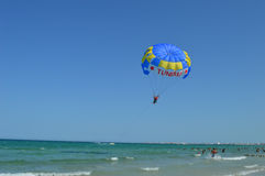 Boat that pulls the parachute rope off the coast of Tunisia beach Royalty Free Stock Image
