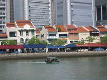 Boat Quay @ Singapore. Boat Quay is near the business district, Raffles Place MRT in Singapore. It was converted from rows of shop houses to become a popular Stock Photo
