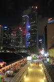 Boat Quay and Singapore skyline by night Royalty Free Stock Images