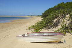 Boat on a quiet lake in Portuguese island, Mozambique Royalty Free Stock Images