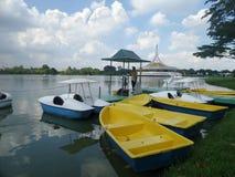 Boat in quiet lake in public park in Bangkok Stock Photo