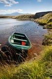 Boat on quiet scottish lake Stock Photography
