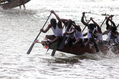 Boat races of Kerala. Oarsmen of a snake boat team row aggressively in the Pumba Boat race at Thiruvalla, Kerala, India stock photography