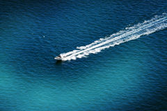 Boat racing in the sea Royalty Free Stock Photo