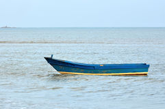 Boat at the raging sea Stock Images