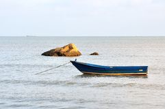 Boat at the raging sea Stock Photo