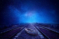 Boat on Railway Track galaxy stary sky Stock Image