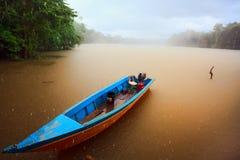 Boat in rain Royalty Free Stock Image