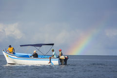 Boat and rainbow over Indian ocean Stock Image