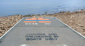 Boat Ramp With Life Jacket Warning. Stock Photos
