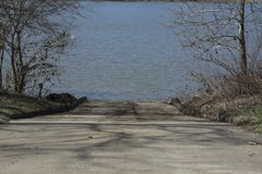 Boat ramp on the Ohio river. A concrete ramp leads to the water of the Ohio river allowing launching of boats stock photo