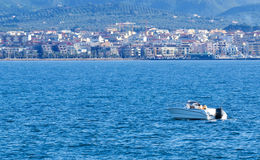 Boat reaching the coast. Speedboat reaching the coast in Sardinia Royalty Free Stock Photography