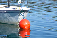 Boat and Red Buoy Lake Reflection Royalty Free Stock Images