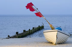 Boat with red flags Stock Images