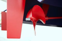 Boat red paint propeler helix in blue hull boat Royalty Free Stock Photos