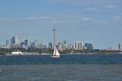 Boat with red rimmed spinnaker sails Toronto harbour Stock Photography