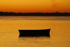 Boat in a red river. Litle boat in a red river stock photography
